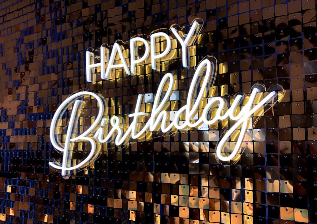 Gold Sequin Wall with Happy Birthday Neon Sign
